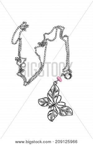 Elegant silver necklace with butterfly pendant on white background