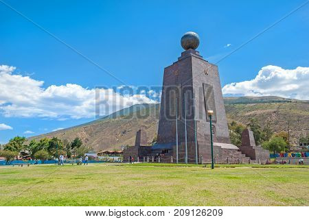 Monument at the Middle of the World, touristic attraction, north of the capital of Ecuador, Quito, on a sunny summer day