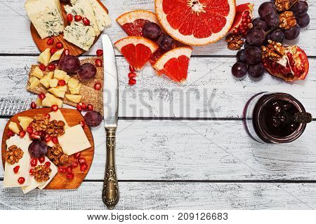Gourmet Cheese Assortment On Wooden Table