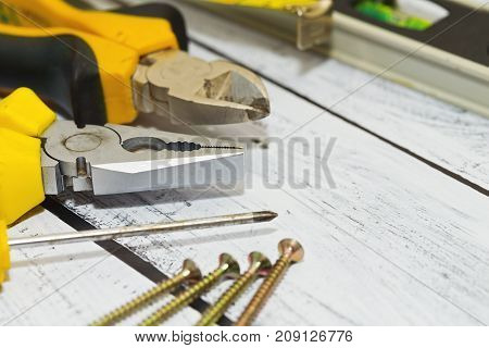 Work Tools On Wooden Desk