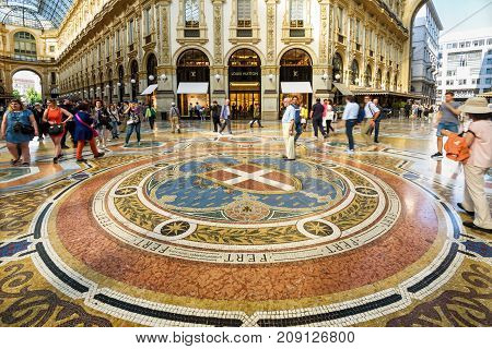 Milan, Italy - May 16, 2017: Tourists are walking in the Galleria Vittorio Emanuele II on the Piazza del Duomo in central Milan. This gallery is one of the world's oldest shopping malls.