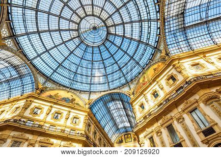 Milan, Italy - May 16, 2017: Interior of Galleria Vittorio Emanuele II on the Piazza del Duomo in central Milan. This gallery is one of the world's oldest shopping malls.