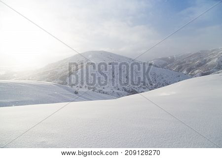 beautiful snow mountain at dawn sun . In the park in nature