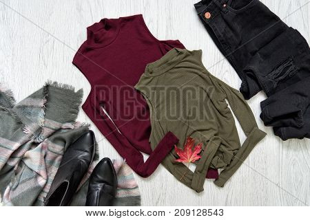 Tops Color Khaki And Burgundy. Black Jeans, A Scarf And Boots. Fashionable Concept