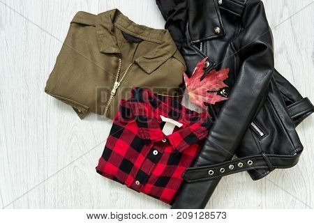 Khaki And Red Checkered Shirt, Black Jacket And Maple Leaf. Fashionable Concept