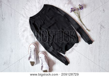 Black Sweater And White Gumshoes. Fashionable Concept