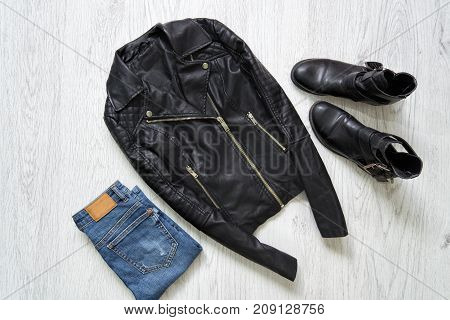 Black Leather Jacket, Jeans And Boots. Fashionable Concept