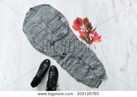 Long Gray Cardigan, Black Boots. Red Autumn Leaves. Fashionable Concept