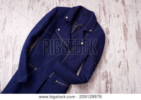 Blue Coat On A Wooden Background. Fashionable Concept
