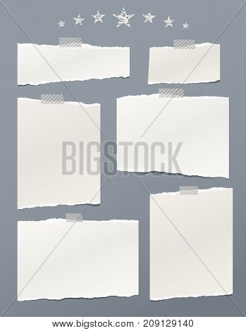 White ripped paper, notebook sheets for note or message stuck with sticky tape on gray background with stars