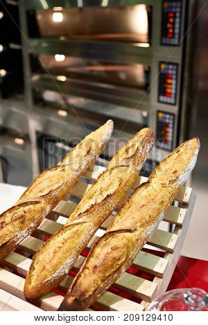 Fresh Baguette Bread And Oven In Bakery