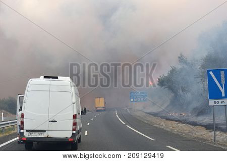 Forest fire on the road in Galicia, Spain