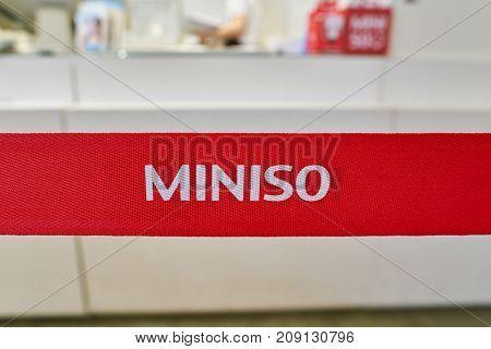 BUSAN, SOUTH KOREA - MAY 28, 2017: close up shot of Miniso sign at Lotte Department Store.