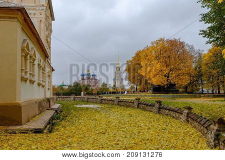 autumn landscape with a view of the Orthodox churches on a background of yellow foliage