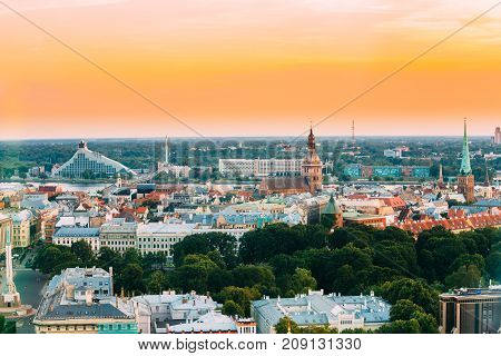 Riga, Latvia - July 2, 2016: Riga Cityscape. Top View Of National Library, Riga Dom Dome Cathedral And National Library. Famous Landmarks In Sunset Light Of Summer Evening. Aerial View At Sunset Time