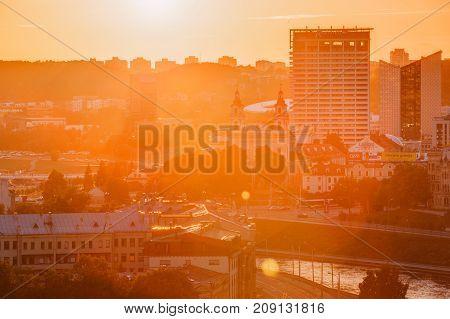 Vilnius, Lithuania - July 5, 2016: Sunset Sunrise Dawn Over Cityscape. Church Of St Raphael The Archangel And Former Jesuit Monastery, Radisson Blu Hotel. Business District New City Centre Shnipishkes