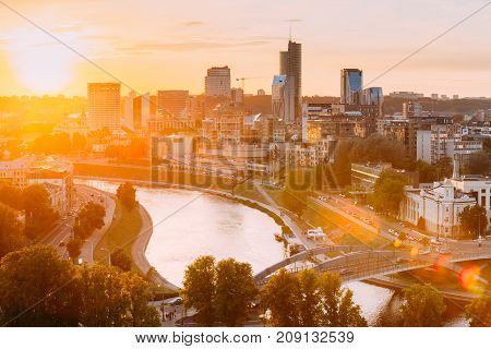 Vilnius, Lithuania - July 5, 2016: Sunset, Dawn Over Cityscape In Evening Summer. Beautiful View Of Modern Office Buildings Skyscrapers In Business District New City Centre Shnipishkes