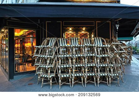 Parisian cafe chairs before opening in early morning