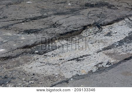 Construction Of A Road In The Streets Of Yards. New Asphalt On The Road. Streams Of Hot Bitumen When