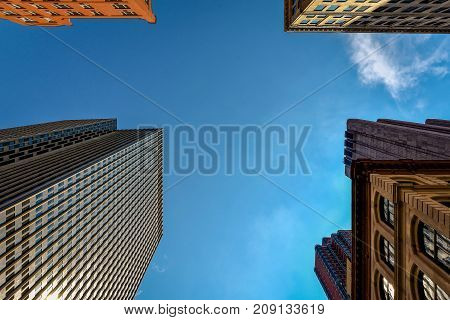 New-York buildings view from street level with blue sky
