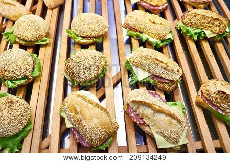 Burgers On Wooden Counter Of Cafe