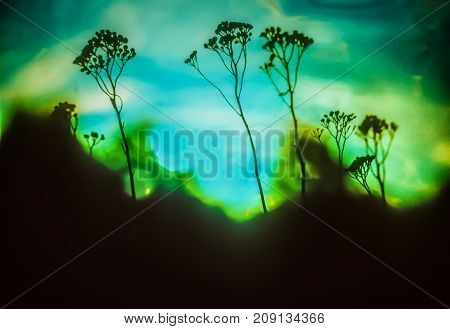 Artistic background with plants on liquid blue and green