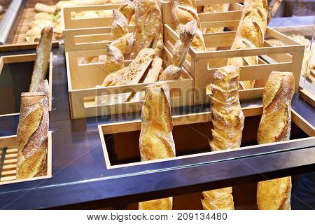Fresh White Bread In Wooden Boxes On Grocery Store