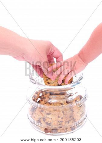 a person hand in a cookie jar.