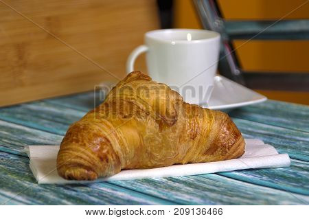 Traditional French butcher croissant on table. Typical european bakery - rogal francuski.