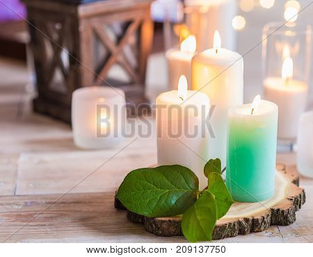 burning candles in transparent glass vases, indoor.