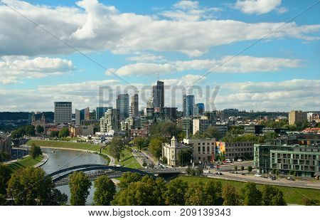 Vilnius, Lithuania - August 14 2017: The modern skyline of Vilnius' Financial Center and Neris river at summer day view from Gediminas' Tower.