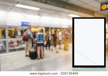 blank advertising billboard or showcase light box with copy space for your text message or media and content with people waiting subway at train station commercial marketing and advertising concept