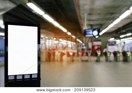 blank advertising billboard or showcase light box with copy space for your text message or media and content with entrance of subway at train station commercial marketing and advertising concept