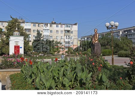 Evpatoria, Republic of Crimea, Russia - July 21, 2017: Square named after Marshal Sokolov with the chapel of St. George the Victorious and the monument to Sergei Leonidovich Sokolov in the city of Evpatoria
