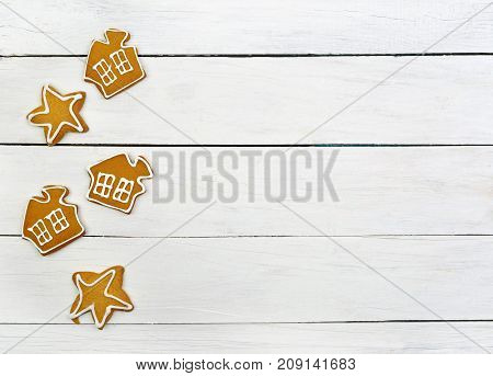 Christmas sweets baking gingerbread cookies . Christmas cookies gingerbread on white table . New Year food. top view. Food background. Christmas background.