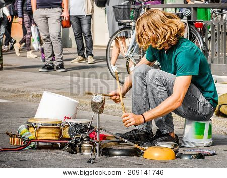 percussionist use pots and pans to play drums - busker street artist musician