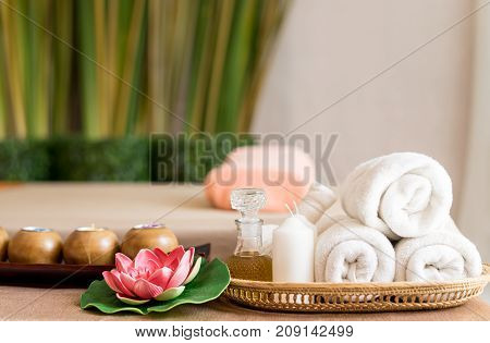 White towels and Spa objects on Spa Massage bed