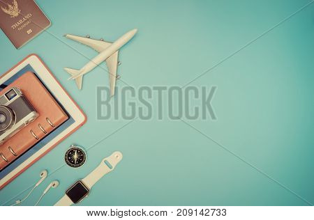 Travel objects and gadgets for travel concept on blue vintage tone
