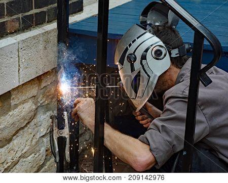 Welder Welding Clamped Metal