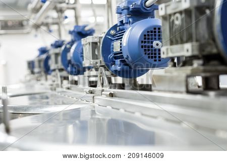 Electric motors on steel tanks for mixing liquids, modern production of alcoholic beverages. Food industry.