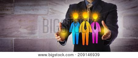 Unrecognizable male recruiter is forming a work team of three bright candidates. Human resources metaphor for team building inspiration staffing solution entrepreneurship and talent management.