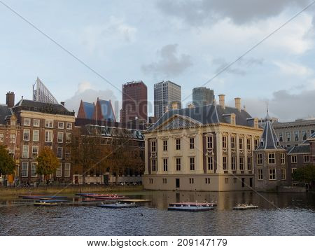 The Hague the Netherlands - 12 October 2017: Mauritshuis museum historic Binnenhof buildings iand modern skyscrapers of The Hague in background