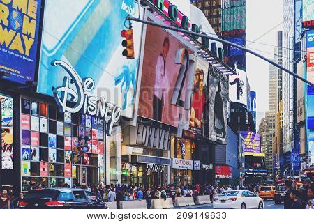 NEW YORK NEW YORK - September 4th 2017: detail of busy Times Square in Manhattan Nyc with plenty of billboards and tourists (unidentified people)