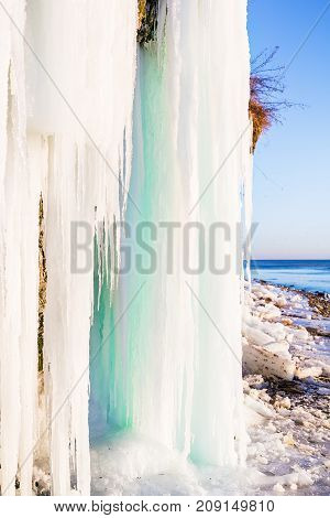 Icicles on the rocks. Beautiful winter landscape
