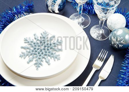 a decorated christmas table with cristal glasses