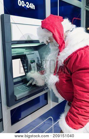 Santa Claus at ATM machine. Santa Claus