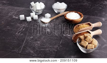 Various types of sugar brown sugar and white on grey background