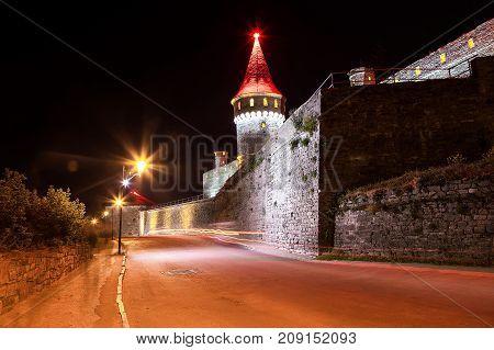 Beautiful castle on a mountain hill. Kamenetz-Podolsk, one of the historical monuments of Ukraine.