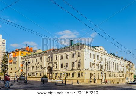 Belgorod Russia - September 29 2017: Prospect of Glory. Building with an arch vault built in the Soviet Stalin era. Old city center. Urban environment.