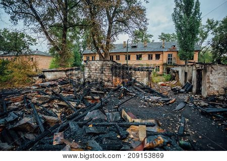 Completely burned wooden house in destroyed by fire district of the city